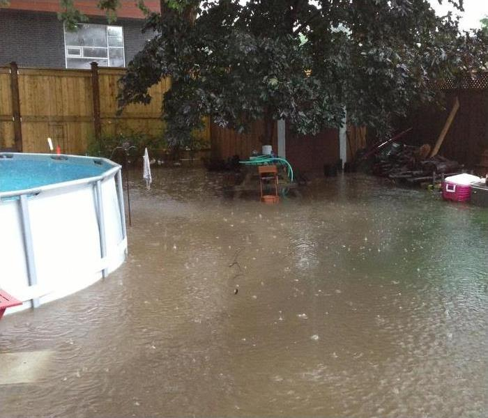 Backyard of West El Paso Home Flooded from a Storm